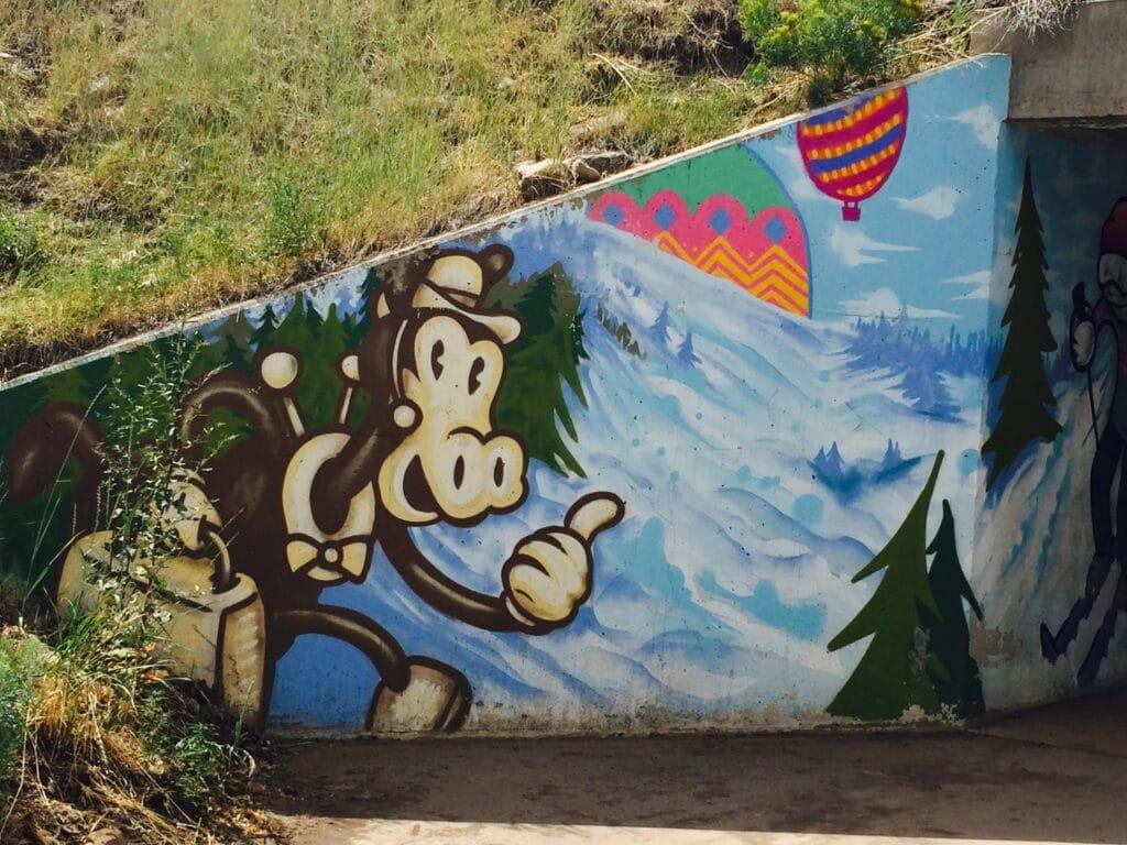 Street Art painting of a nostalgic traveler in artist Trent Call's signature cartoon style.