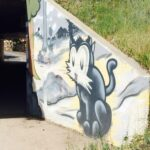 Street Art painting of a nostalgic pussy cat in artist Trent Call's signature cartoon style.