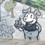 Street Art painting of a nostalgic server in artist Trent Call's signature cartoon style.