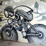 Street Art painting of a nostalgic road biker in artist Trent Call's signature cartoon style.