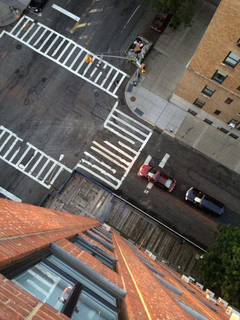 Photo of an intersection and cross walks taken from the 14th floor looking straight down in New York City