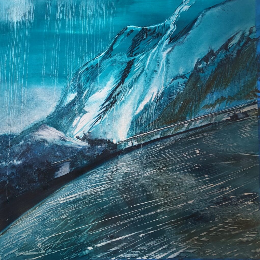 An icy road winds through the mountain pass and slips under a silver bridge. A blue/green sky drips and reflects over this cold landscape. Cynthia McLoughlin©2018