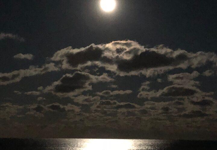 Photo of the moon over the ocean/beach in NJ by Cynthia McLoughlin