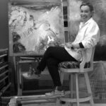 Black and white photo of Cynthia McLoughlin in her studio.