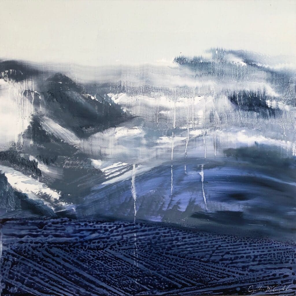 A deep blue pebbled forground fades into the melting snowy mountains shrouded in a foggy blur of drippy atmosphere.