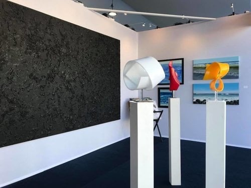 Sculpture and abstract paintings in the booth at the Monaco Yacht Show, 2019.