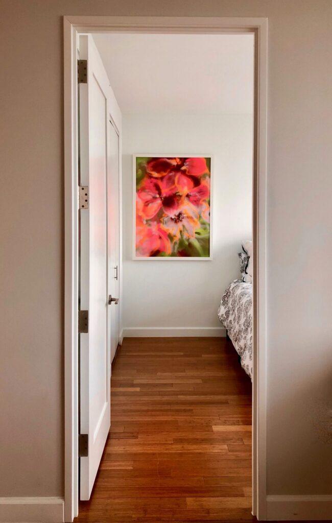 Pink, vertical floral hangs in the bedroom.