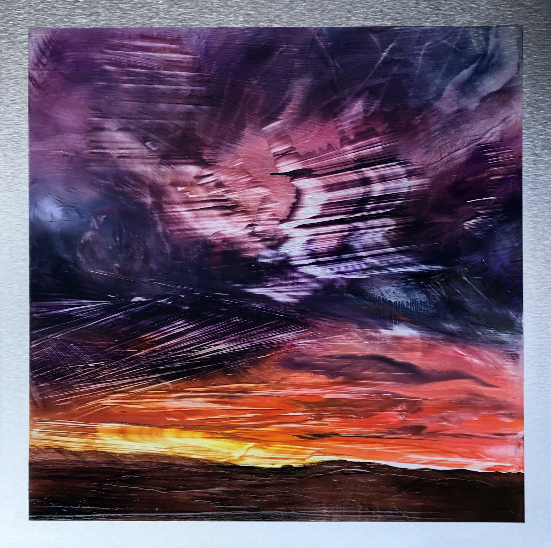An original oil painting on metal panel by artist Cynthia McLoughlin of a flaming, dramatic sunset.